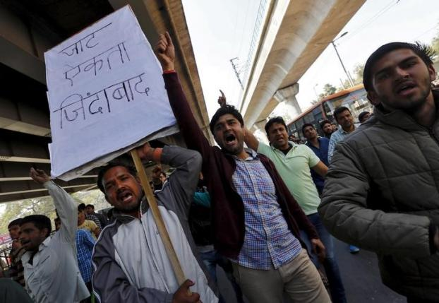Demonstrators from the Jat community shout slogans during a protest in New Delhi, India, February 21, 2016. REUTERS/Adnan Abidi